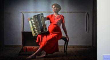 Balancing Act pregnant woman in red dress artwork Aldona Kmiec