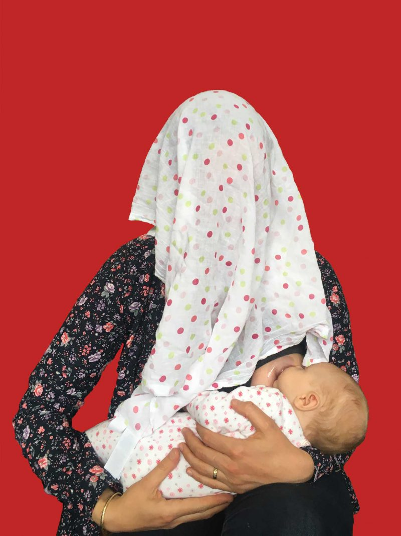 Mother breastfeeding baby in red Mass Isolation Australia